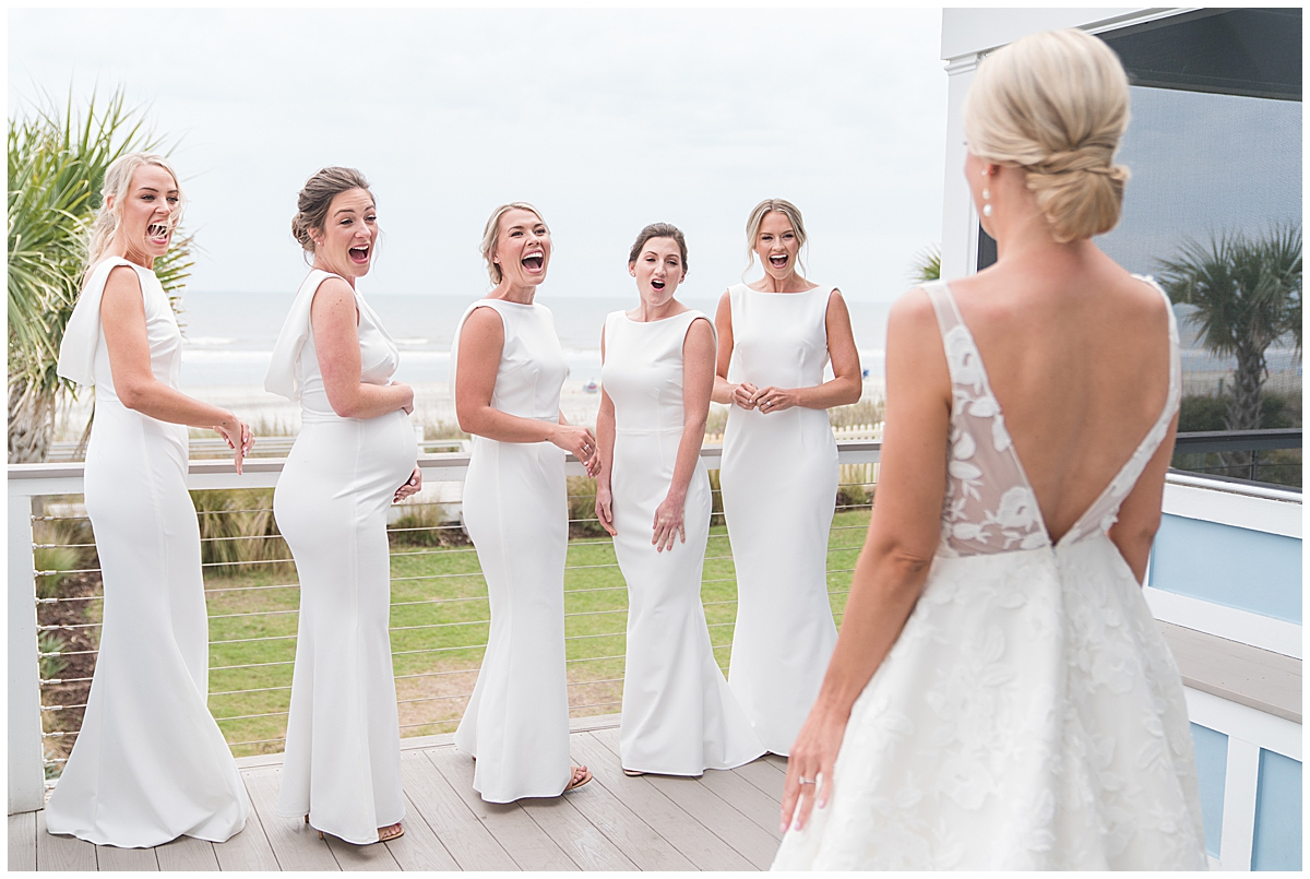 bridesmaids have first look with bride before SC wedding