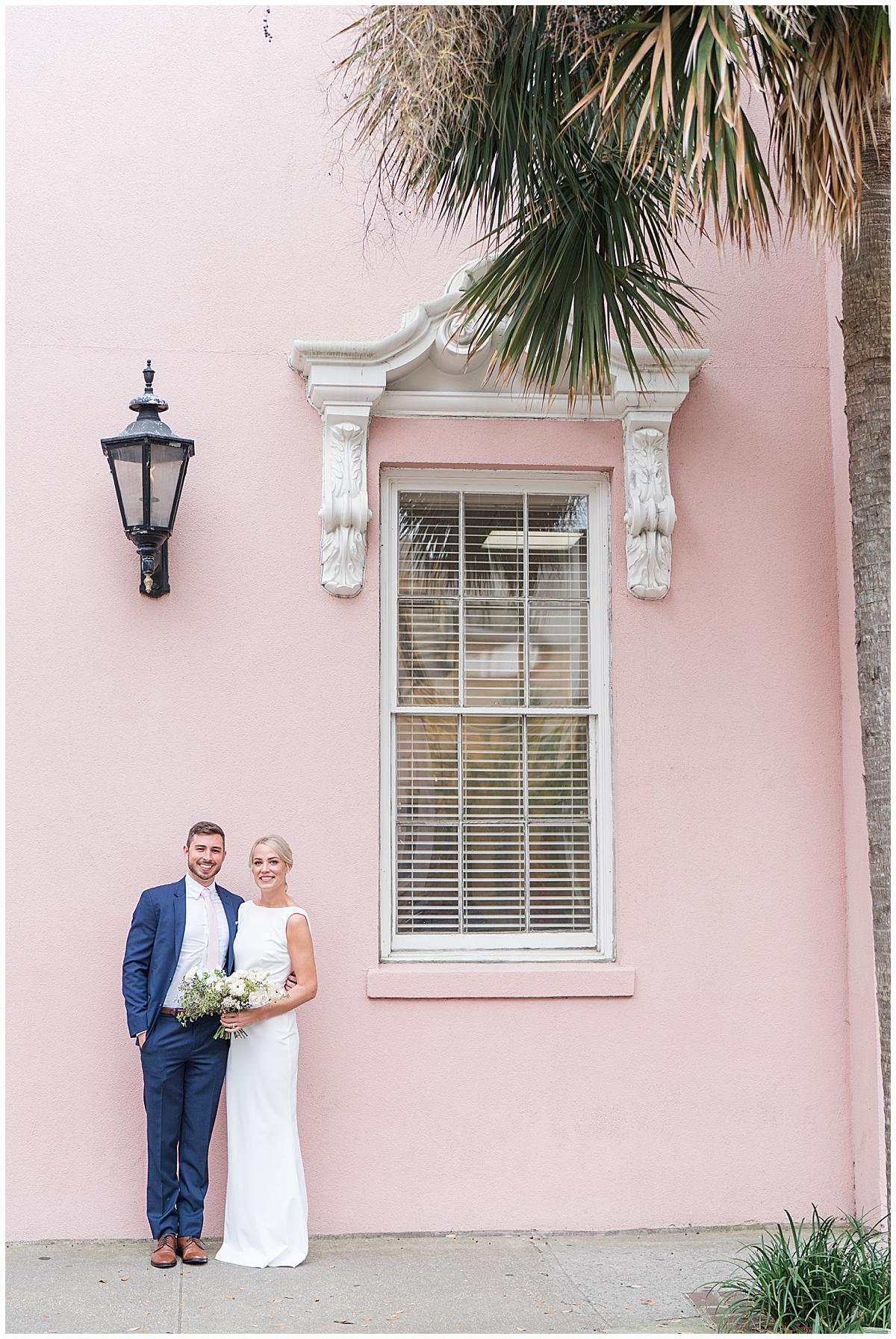 bride and brother hug by Charleston home