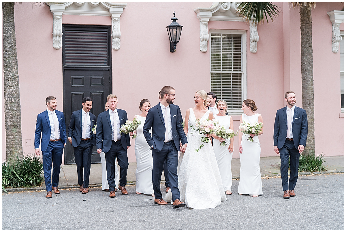 bride and groom walk in Charleston with wedding party