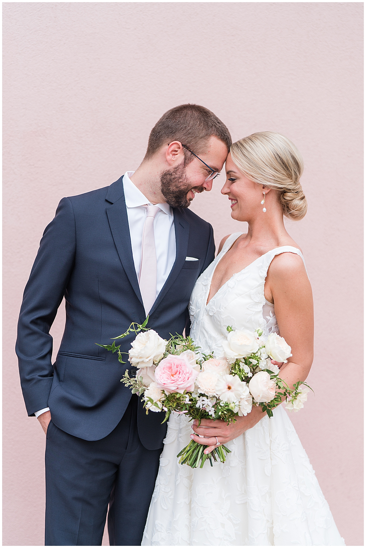 bride and groom pose with heads touching in Charleston SC