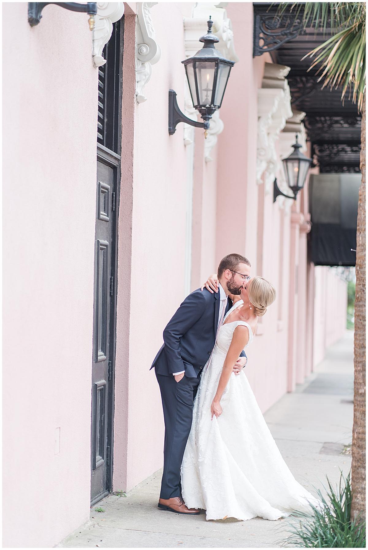 groom kisses bride during Charleston SC wedding photos
