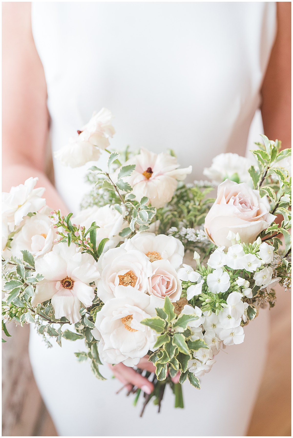 bride holds bouquet of white and pink flowers