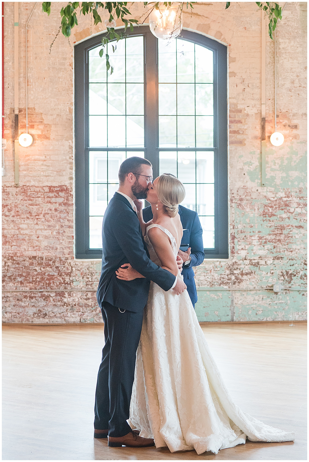 bride and groom kiss during ceremony at Cedar Room Charleston
