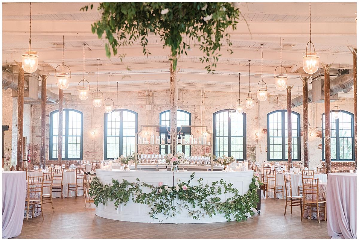 Cedar Room Charleston wedding reception bar in the center of the room