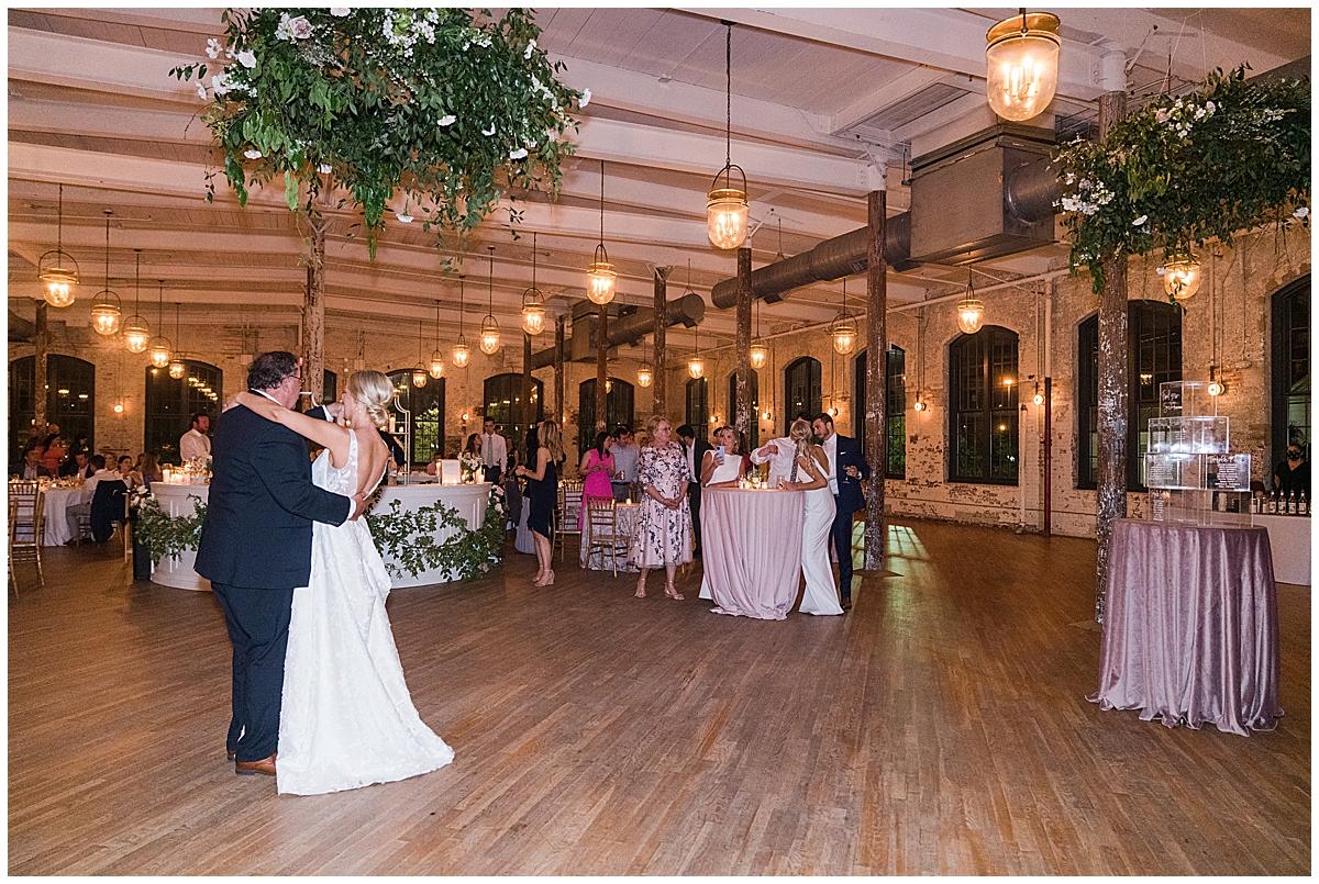 bride and dad dance during Cedar Room wedding reception