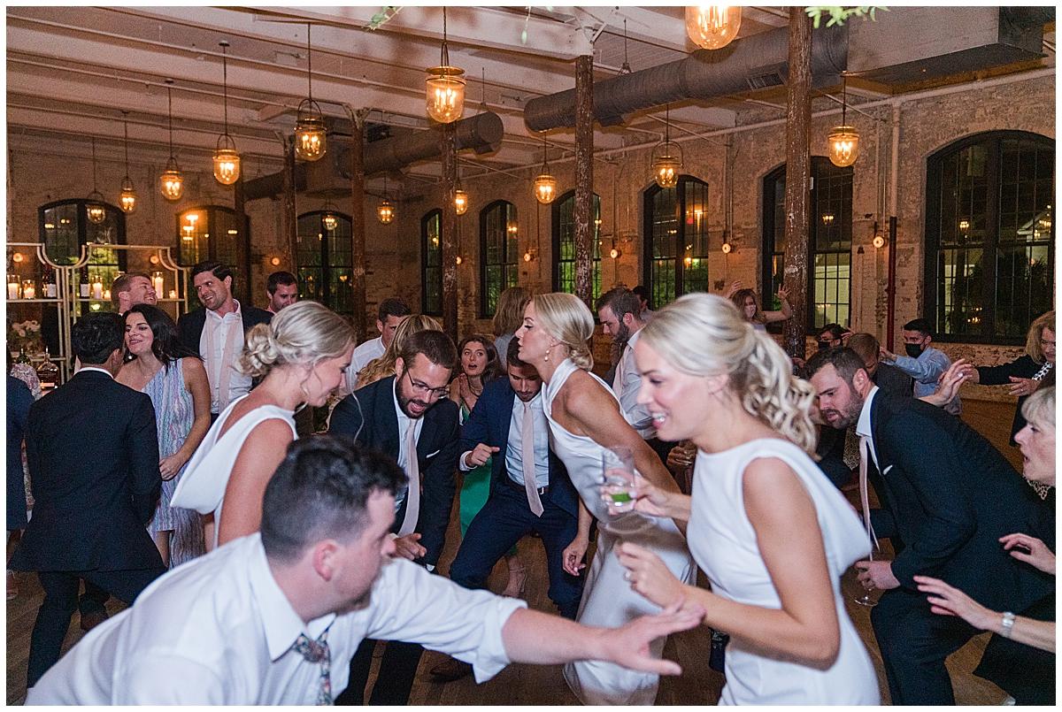 guests dance during Cedar Room Charleston wedding reception