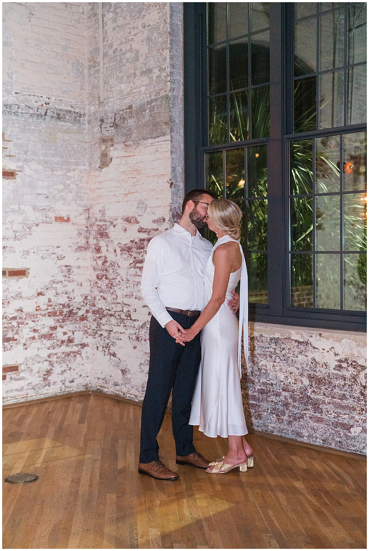 bride and groom kiss during Cedar Room Charleston wedding reception