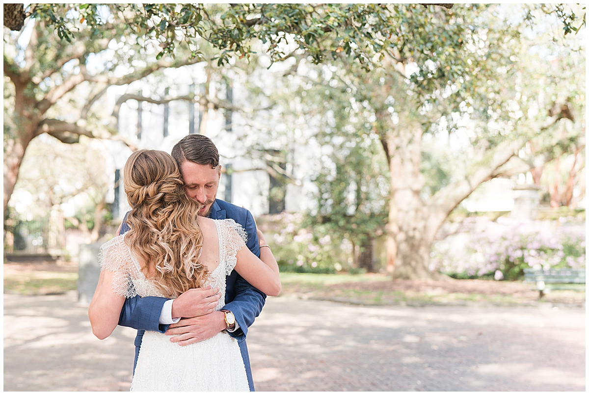 groom hugs bride during Charleston SC wedding photos