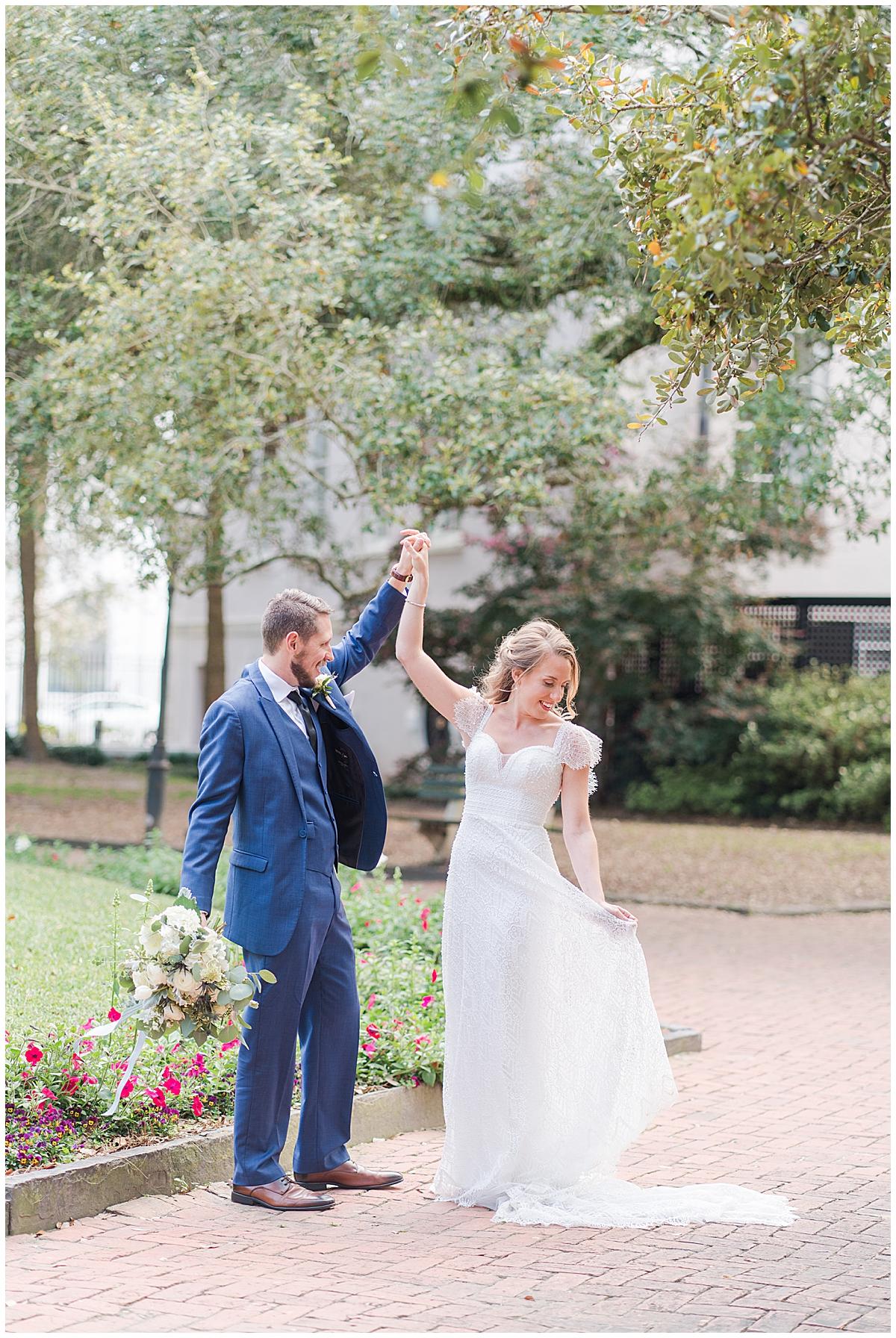 groom twirls bride during Charleston wedding photos