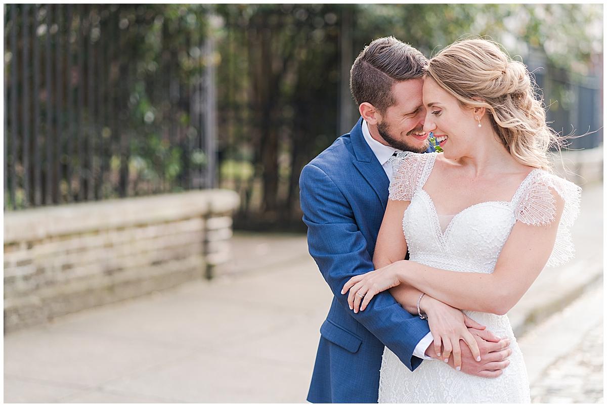 groom hugs bride in Charleston SC