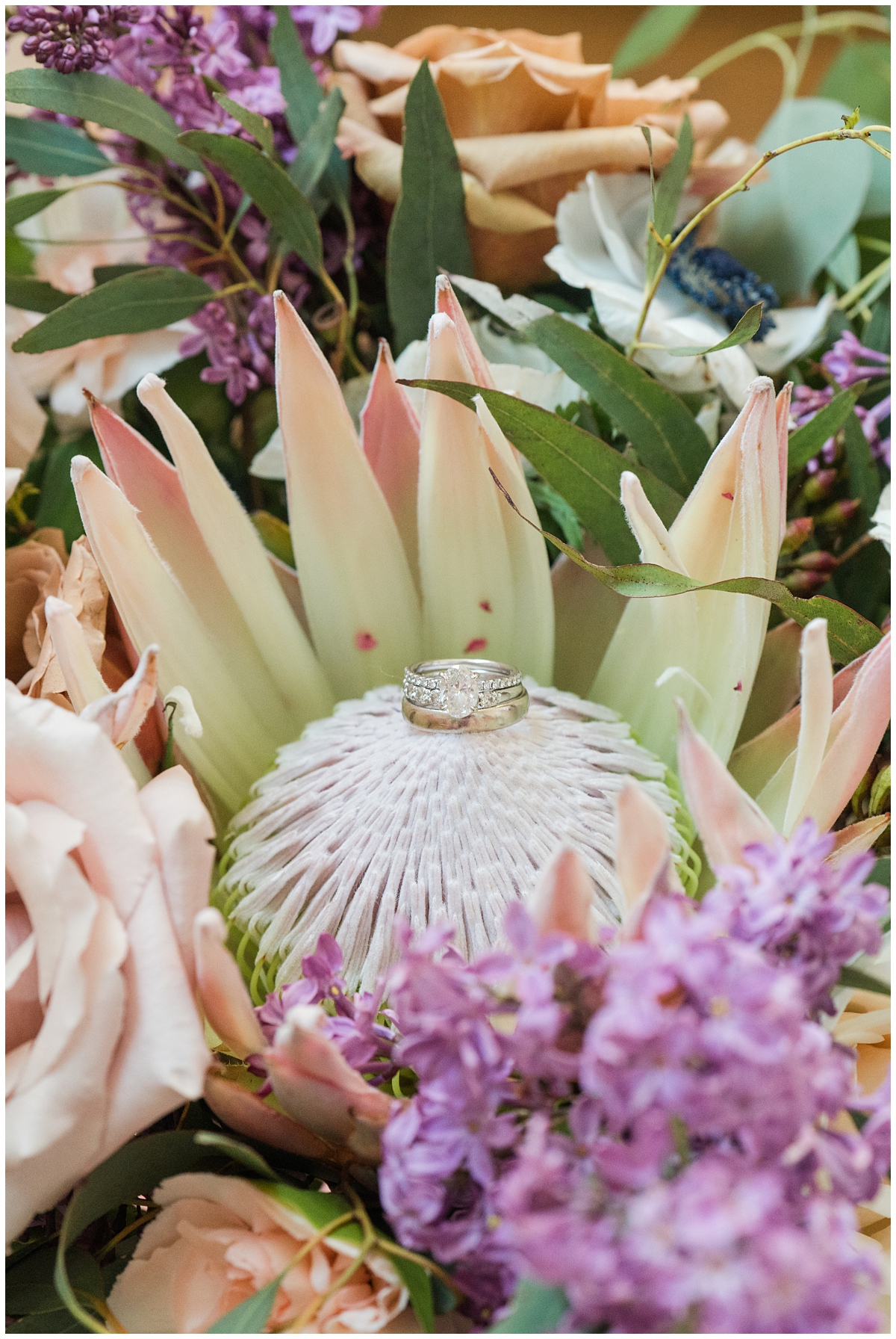 engagement ring rests on bouquet in Charleston SC