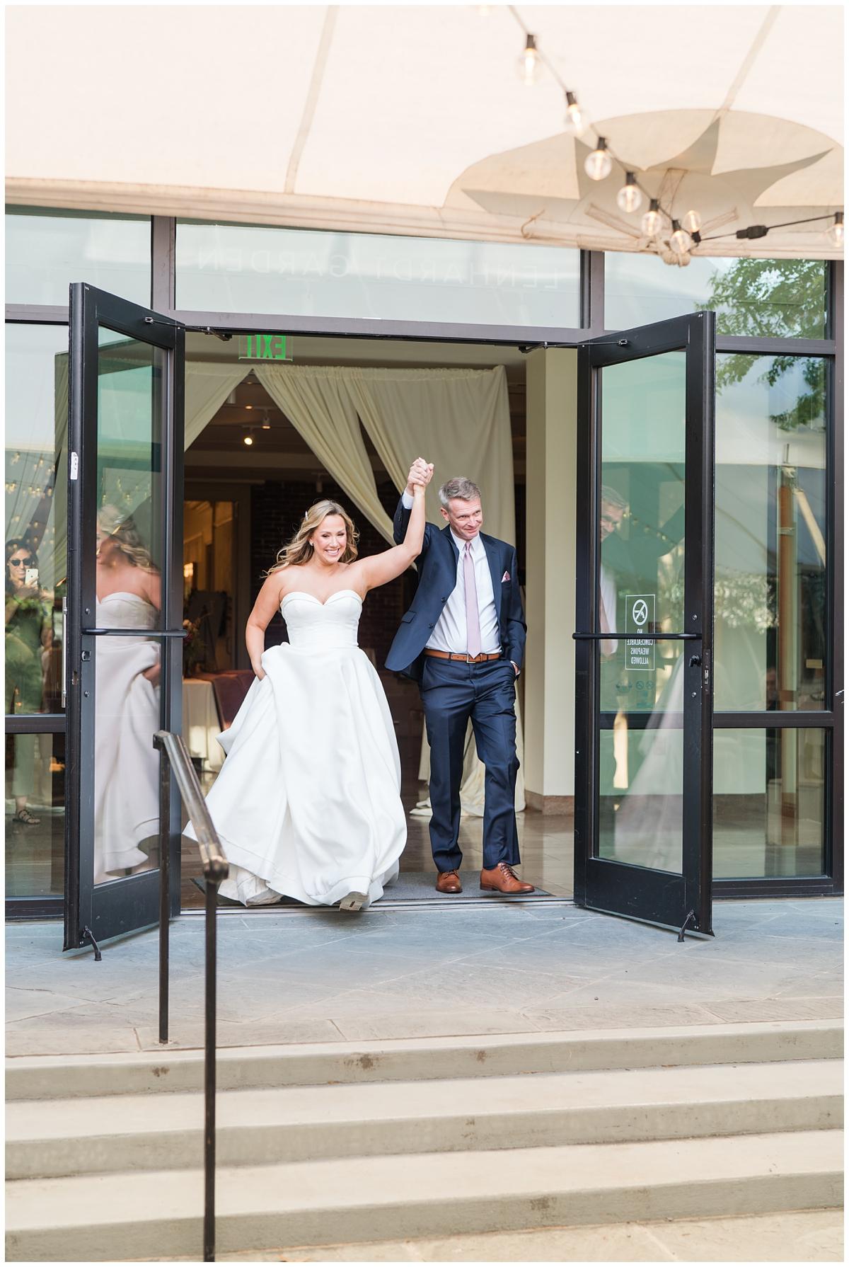 newlyweds enter SC wedding reception at Gibbes Museum