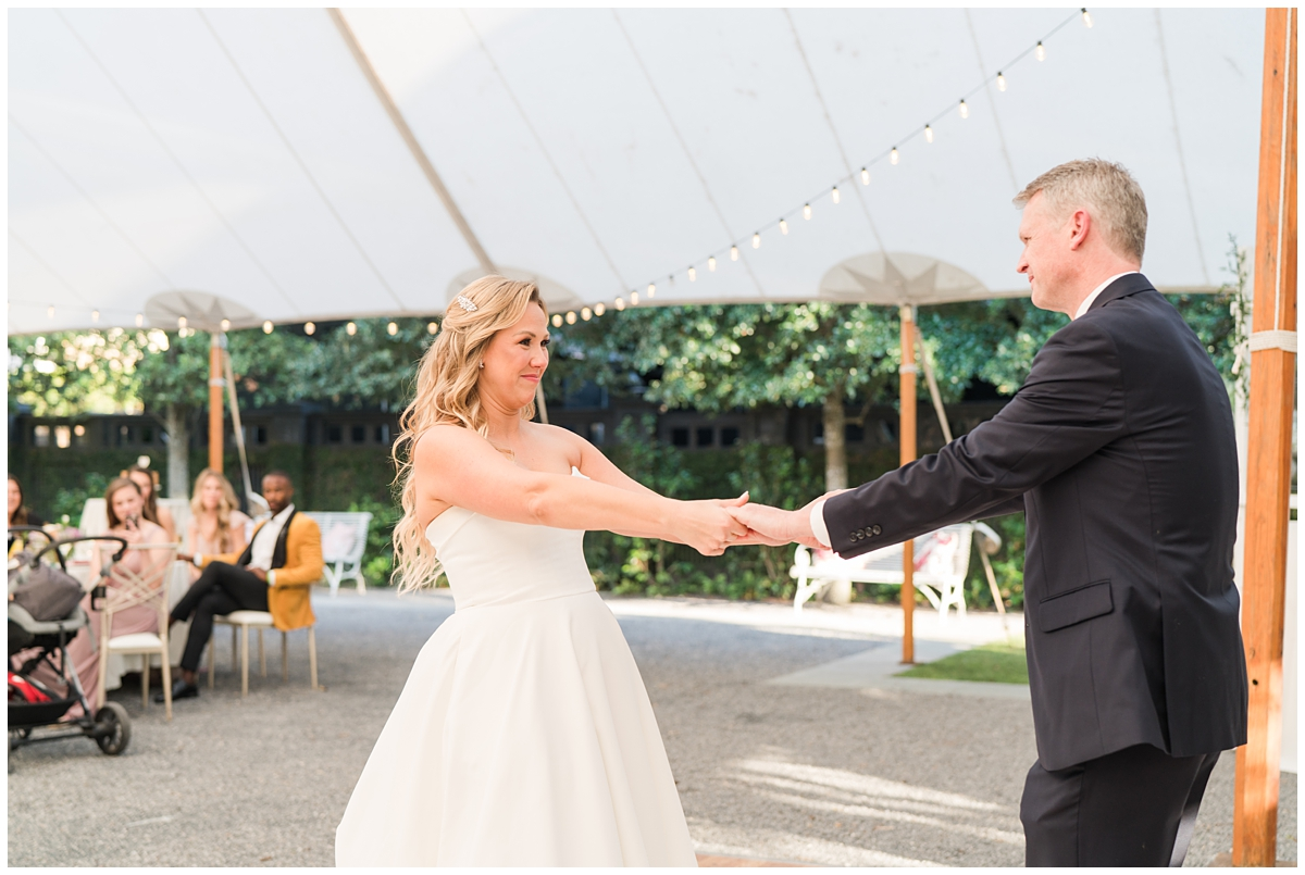 couple dances together during wedding reception