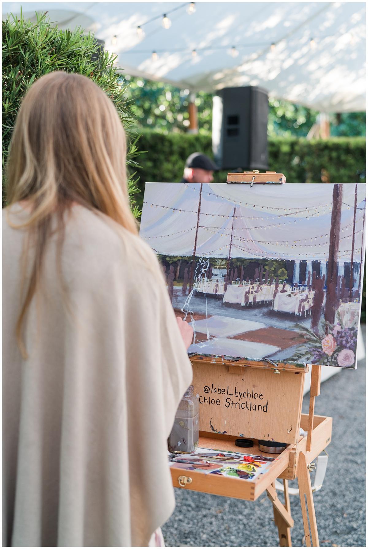 live painter works on reception portrait