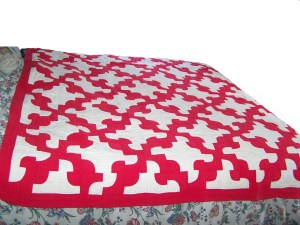 red and white quilt - drunkards path