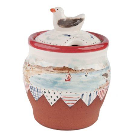 A photo of a handmade ceramic seaside design storage jar with seagull handle
