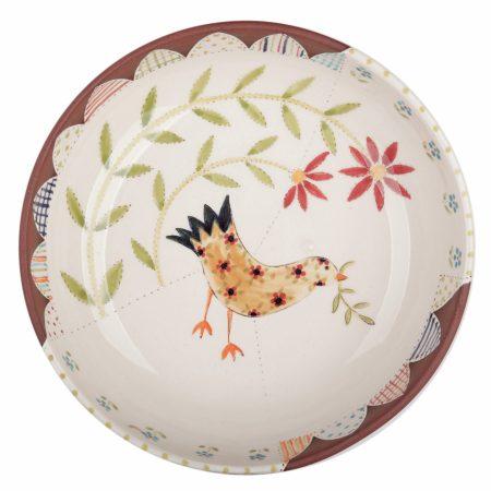 A photo of a handmade ceramic folk art design pasta bowl