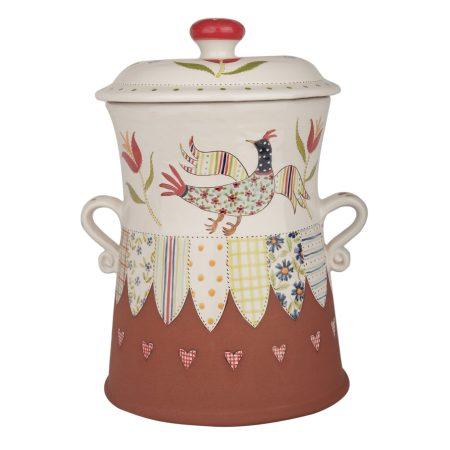 A photo of a handmade ceramic folk art design bread crock