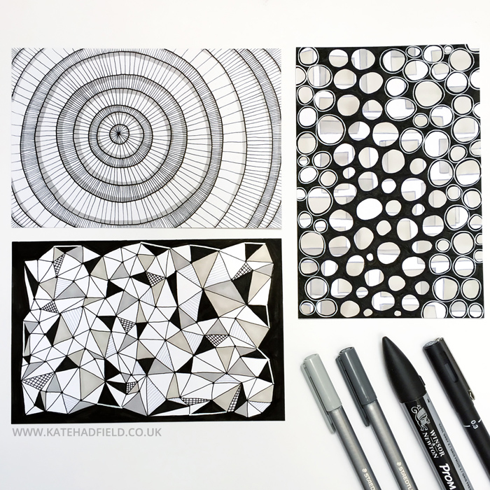 black and white geometric patterns drawn on index cards