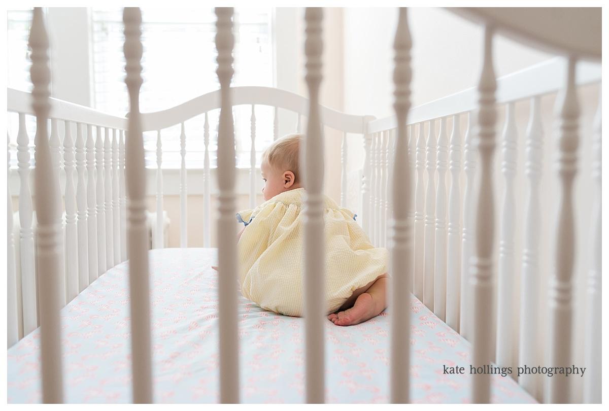 Baby girl in crib