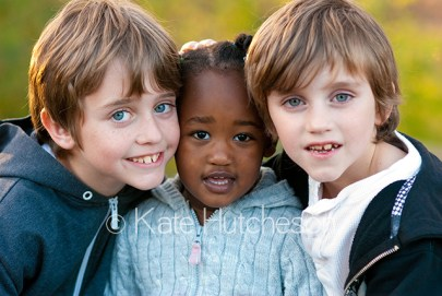 nice portrait of 3 young siblings