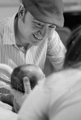 Daddy smiles at his baby