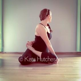 yoga instructor stretching