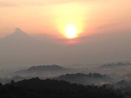 Sunrise over Borobudur, with Merapi to the left