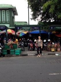 Casey in front of the market