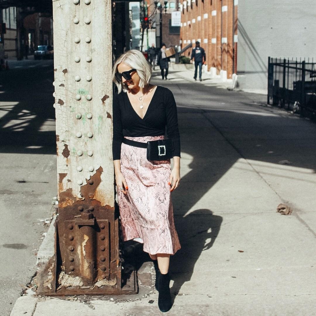 sunglasses and snake print midi skirt