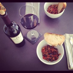 Dinner Table of Ratatouille with Rust Bread and Menage a Trios Red