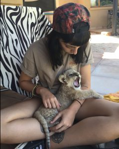 Beth Jennings with a lion cub