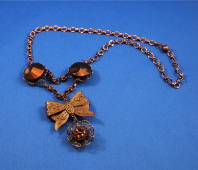 Vintage buttons and filigree necklace by Monica Rice