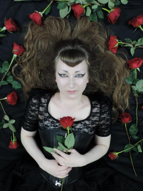 Kat lying with roses