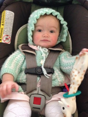 Scout's first Easter, complete with Pippin's owl cardigan and her own womanly bonnet.