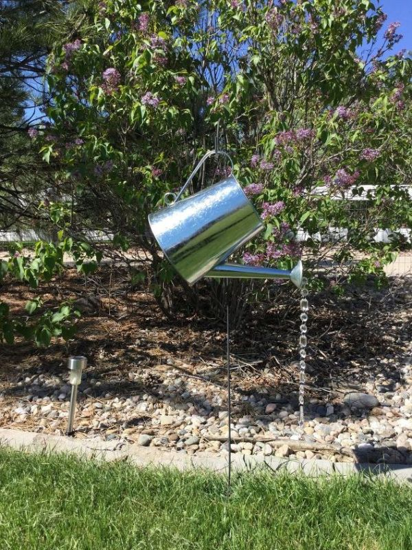 diy watering can yard art