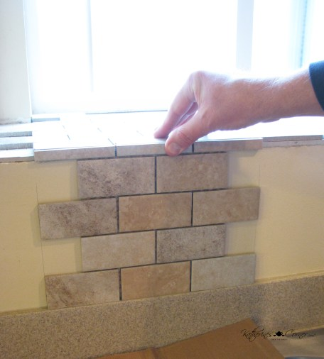 placing tiles for backsplash