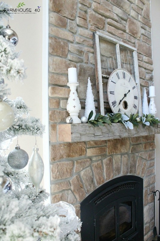 snow covered living room christmas tree