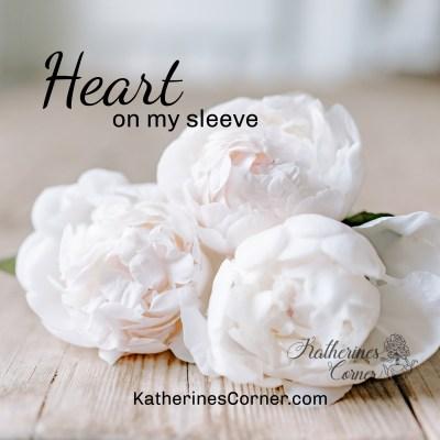 white silk flowers heart on my sleeve