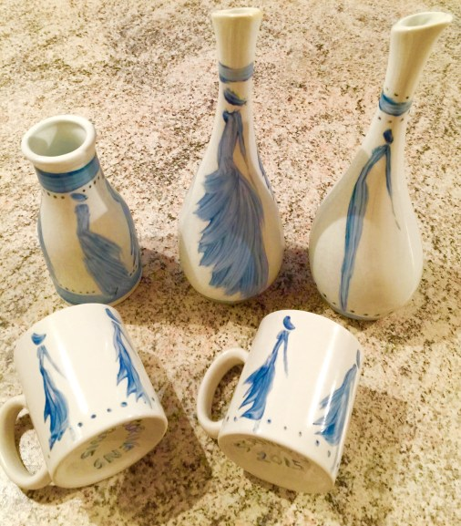 Dancing blue silhouettes on vases and cute espresso mugs.