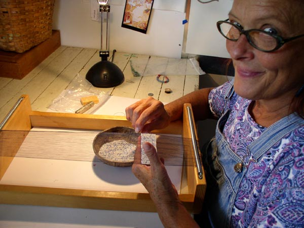 Collis Marshall enjoying her bead loomwork