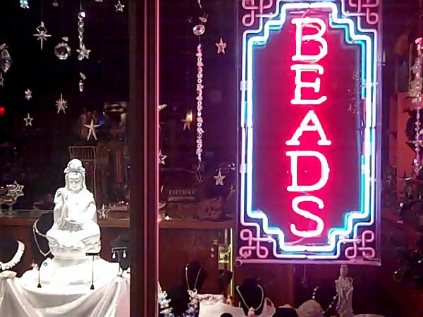 Nomad Beads storefront at night