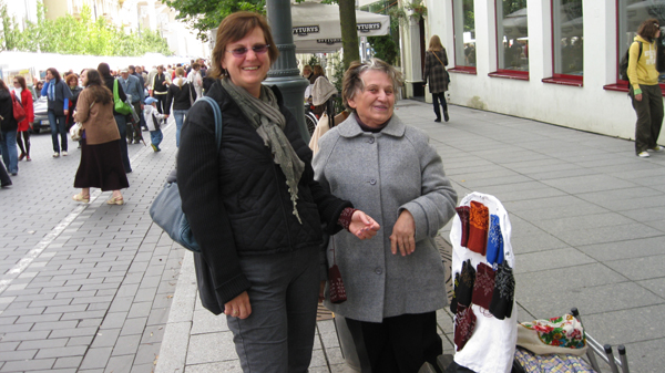 Donna buying wristers in Vilnius Lithuanina