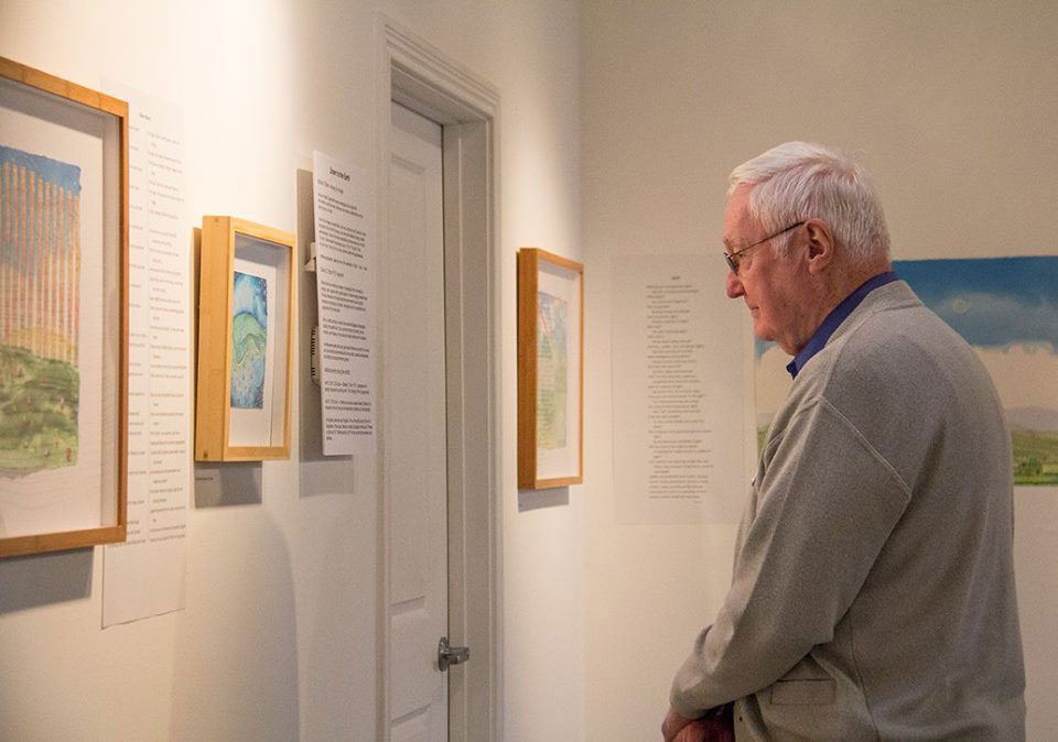 "Stan Brunn looking at ""Blue Planet Closeup, River Ocean"", photo credit Melissa Hall"