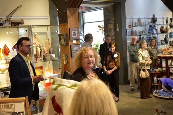 """Curator Gwen Heffner's exhibit talk with Director Todd Finley at """"225: Artists Celebrate Kentucky's History"""" reception: photo, Greg Orth"""