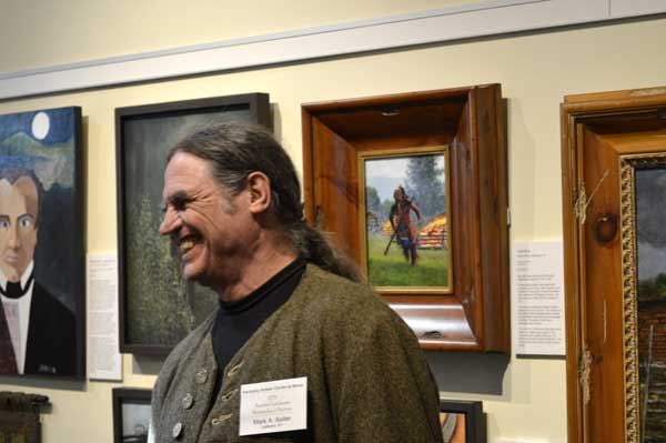 """Mark Selter with his oil paintings at """"225: Artists Celebrate Kentucky's History"""" reception: photo, Greg Orth"""