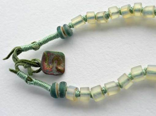 © Kathleen O'Brien, Talisman for Harmony, knotted necklace, opalized glass 1800, Dutch annular beads 1700, Raku button, 23""