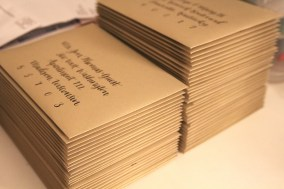 Our envelopes with calligraphy by Emily Cavanagh, dash/wood.