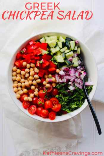 Greek Chickpea salad ingredients in bowl with text