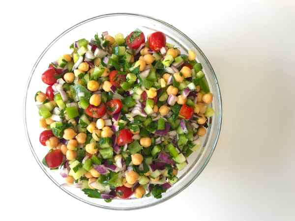 Greek Chickpea salad is your vegan side dish solution. No cooking. Healthy, clean ingredients. It's the perfect refreshing salad for Spring and Summer. Great meal prep option and perfect for cold weekday lunches. Recipe at KathleensCravings.com #kathleenscravings #chickpeasalad #vegansides #healthyrecipes #veganmealprep #meatlessmealprep #healthymealprep #chickpearecipes